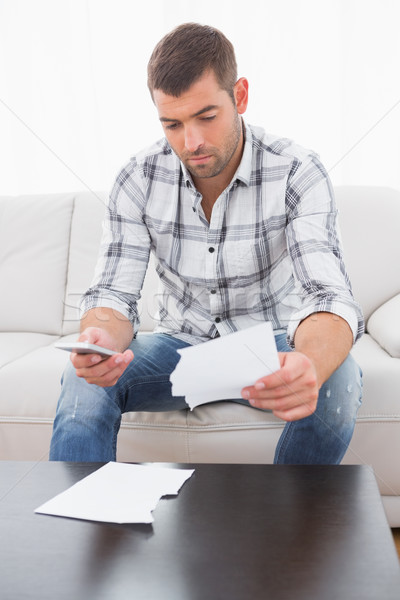 A troubled man looking papers Stock photo © wavebreak_media