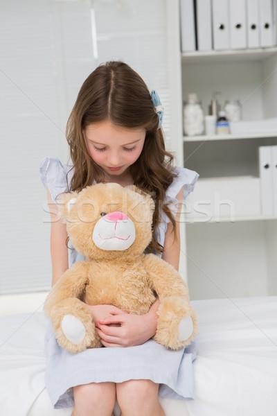 Little girl with her teddy bear in her harms Stock photo © wavebreak_media