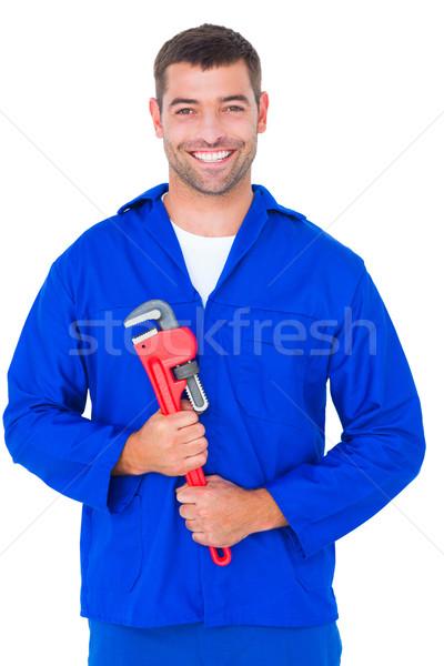 улыбаясь мужчины механиком обезьяны ключа Сток-фото © wavebreak_media