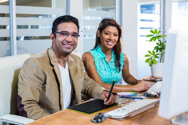 Sorridente parceria negócio computador feliz Foto stock © wavebreak_media