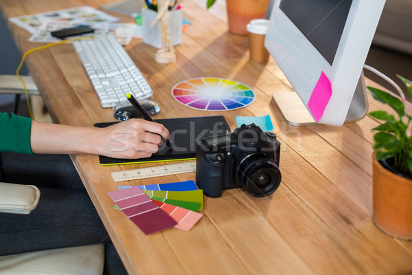 Designer working with colour wheel and digitizer Stock photo © wavebreak_media