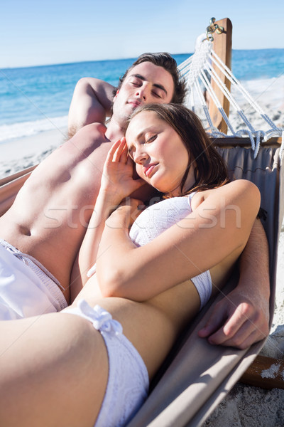 Happy couple napping together in the hammock Stock photo © wavebreak_media