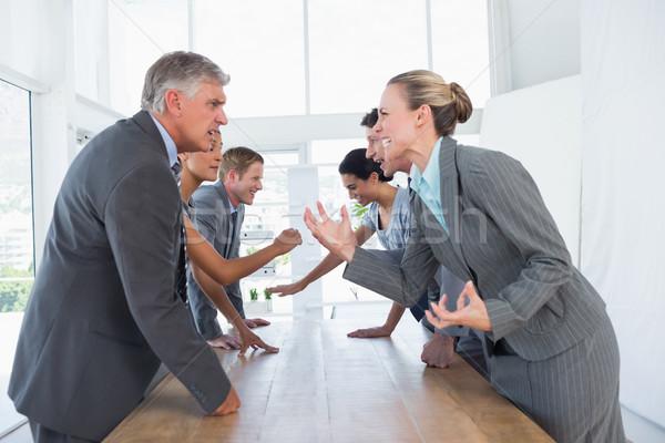 Irritated business team arguing  Stock photo © wavebreak_media