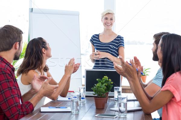 Kollégák tapsol kezek megbeszélés fiatal üzleti csapat Stock fotó © wavebreak_media