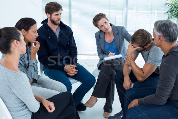 Concerned woman comforting another in rehab group Stock photo © wavebreak_media