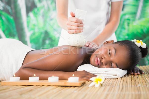 Pretty woman enjoying a herbal compress massage Stock photo © wavebreak_media