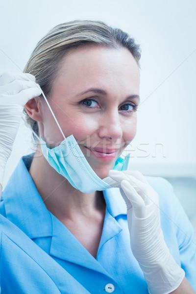 Mosolyog fiatal női fogorvos közelkép portré Stock fotó © wavebreak_media