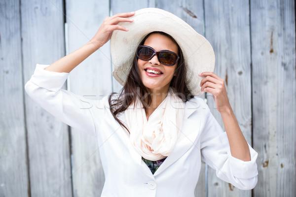 улыбаясь красивой брюнетка соломенной шляпе солнце Сток-фото © wavebreak_media