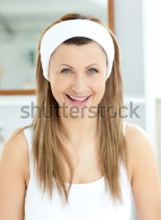 Happy woman smiling at camera with hand on cheek  Stock photo © wavebreak_media