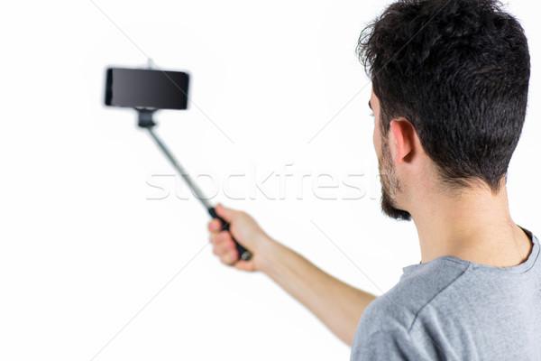 Stockfoto: Toevallig · man · stick · shot · studio · mannelijke