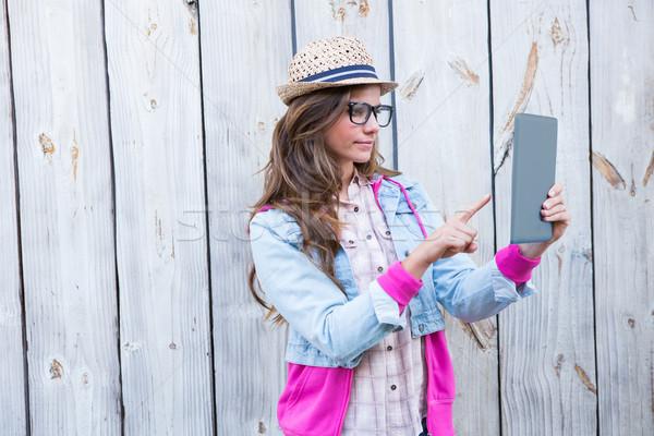 Pretty brunette using tablet pc  Stock photo © wavebreak_media