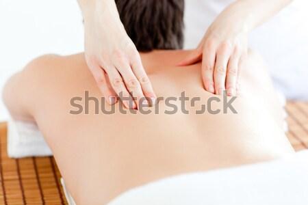 Bruna toccare dolente indietro bianco donna Foto d'archivio © wavebreak_media