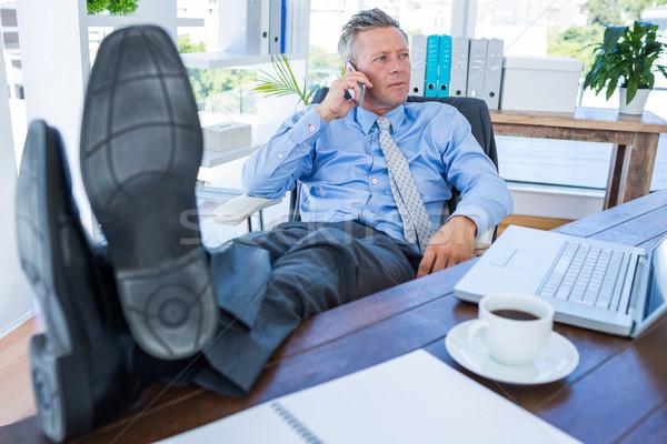üzletember megnyugtató szék telefonbeszélgetés iroda számítógép Stock fotó © wavebreak_media