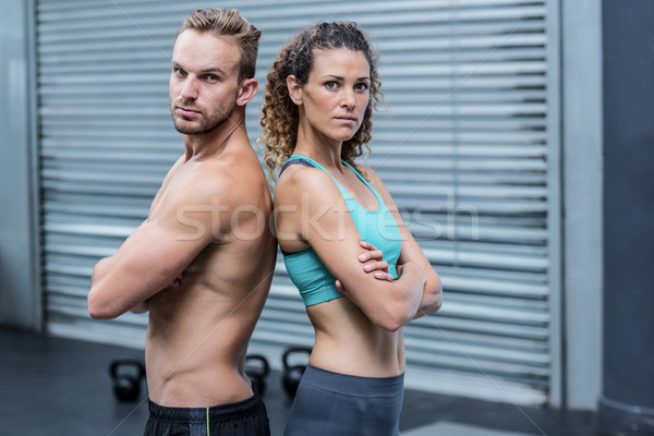 Attentive muscular couple giving back to back Stock photo © wavebreak_media