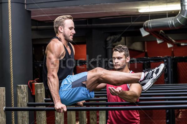 Muscular hombre paralelo bar entrenador salud Foto stock © wavebreak_media