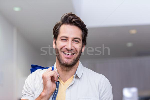 Mosolyog férfi bevásárlótáskák ruházat bolt vásárló Stock fotó © wavebreak_media