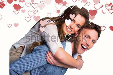 Feliz homem mulher piggyback branco vermelho Foto stock © wavebreak_media