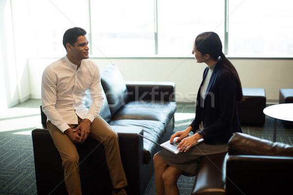 ビジネスマン 女性 同僚 オフィス 座って ソファ ストックフォト © wavebreak_media