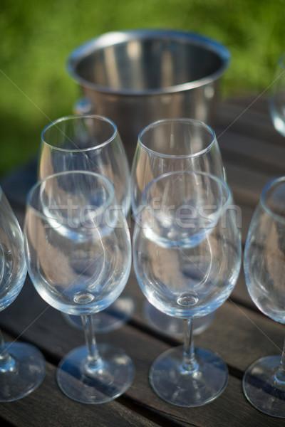 Magasról fotózva kilátás borospoharak asztal üres fa asztal Stock fotó © wavebreak_media