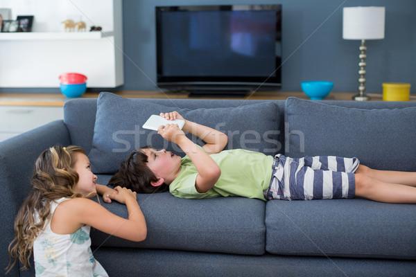 Rodzeństwo cyfrowe tabletka salon domu dziewczyna Zdjęcia stock © wavebreak_media