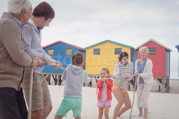 Family playing tug of war at beach Stock photo © wavebreak_media