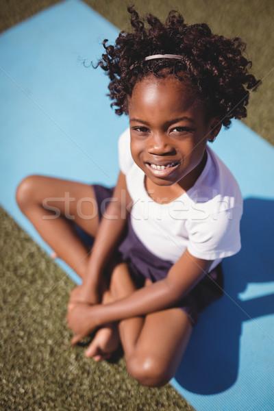 портрет счастливым школьница сидят осуществлять трава Сток-фото © wavebreak_media