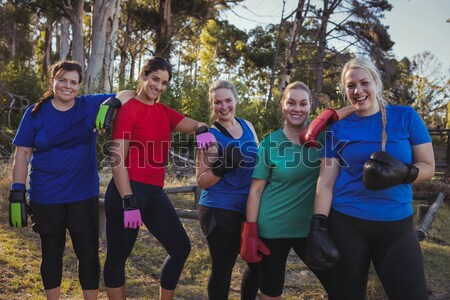 Group of women posing together in the boot camp Stock photo © wavebreak_media