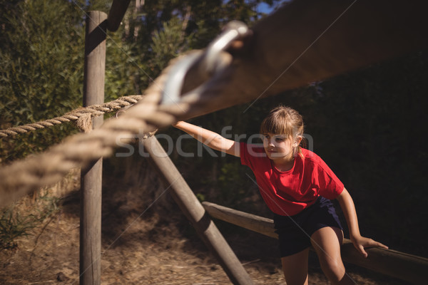 Determined girl exercising on outdoor equipment during obstacle course Stock photo © wavebreak_media