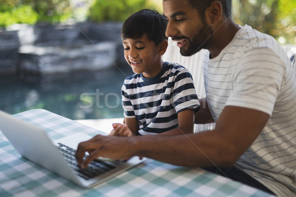 Happy man with his son using laptop at porch Stock photo © wavebreak_media