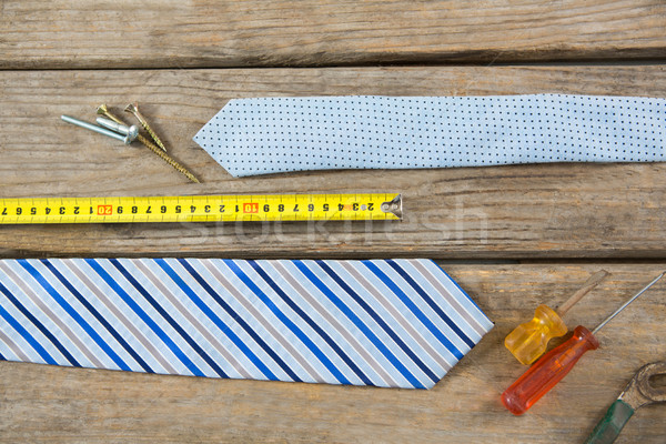 Overhead view of hand tools and neckties on table Stock photo © wavebreak_media