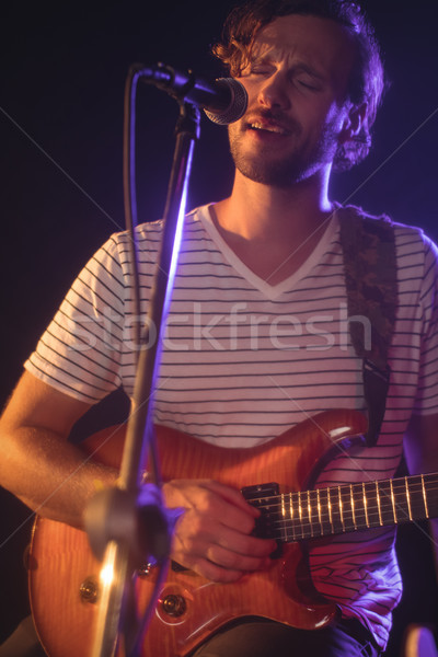 Male singer playing guitar in music concert Stock photo © wavebreak_media