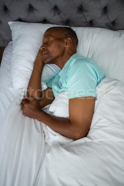 Overhead view of senior man sleeping on bed Stock photo © wavebreak_media
