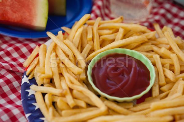картофель фри кетчуп пластина продовольствие вечеринка Сток-фото © wavebreak_media