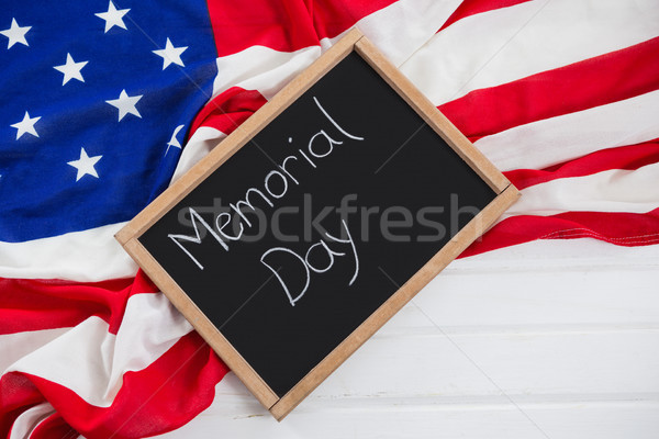 Slate with text and an American flag on wooden table Stock photo © wavebreak_media