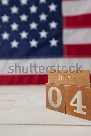 American flag and mobile phone arranged on wooden table Stock photo © wavebreak_media