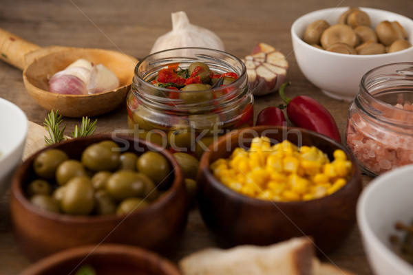 Olives and corns in bowl by spices Stock photo © wavebreak_media