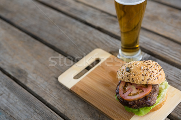 High angle view of hamburger on cutting board by beer Stock photo © wavebreak_media