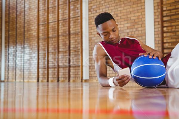 мужчины мобильного телефона полу суд баскетбол Сток-фото © wavebreak_media