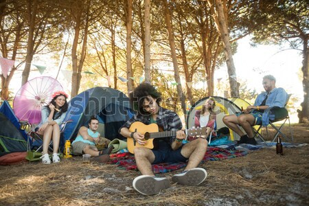 Portrait of young friends with camper van parked at campsite Stock photo © wavebreak_media