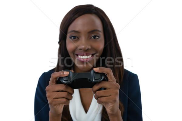 улыбаясь деловая женщина играет видеоигра белый Сток-фото © wavebreak_media