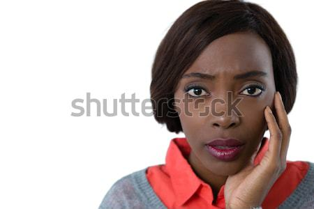 Portrait of surprised young woman with hand on chin Stock photo © wavebreak_media