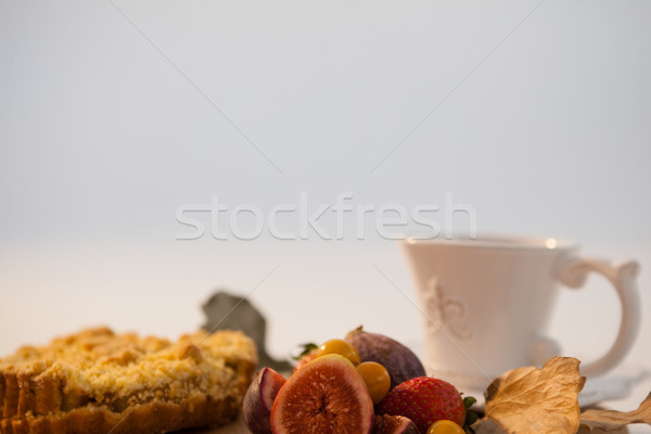 Autumn leaves, various fruits and cup of tea on chopping board Stock photo © wavebreak_media