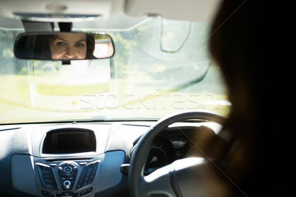Kadın bakıyor ayna sürücü araba Stok fotoğraf © wavebreak_media