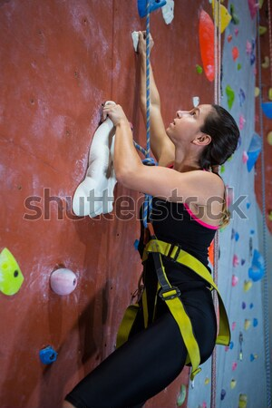 Determined teenage girl practicing rock climbing Stock photo © wavebreak_media