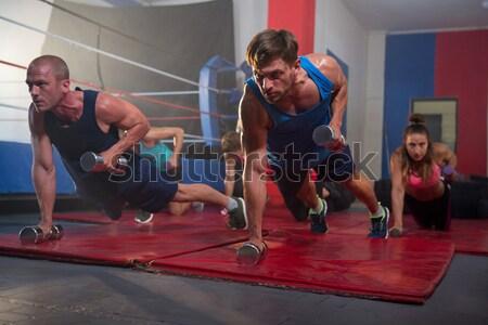 Physiotherapist assisting girl in exercising Stock photo © wavebreak_media