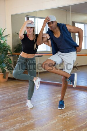 Full length of man assisting dancer in stretching leg on barre Stock photo © wavebreak_media