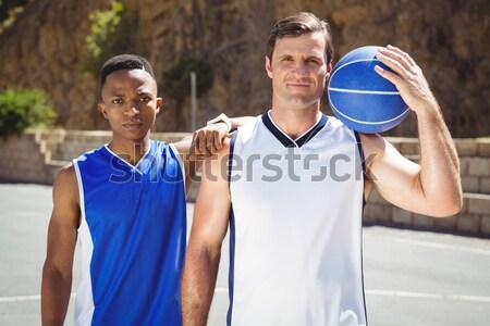 Portrait of smiling sportsperson holding volleyball Stock photo © wavebreak_media