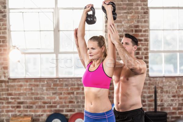 Atento muscular treinador mostrar elevador crossfit Foto stock © wavebreak_media