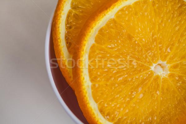 Portion cup of sliced orange Stock photo © wavebreak_media