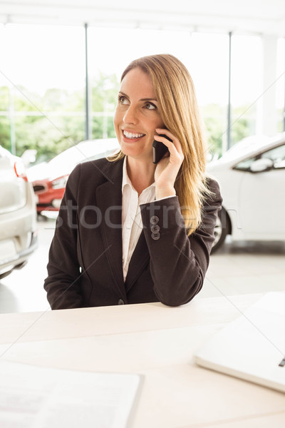 Smiling saleswoman having a phone call Stock photo © wavebreak_media